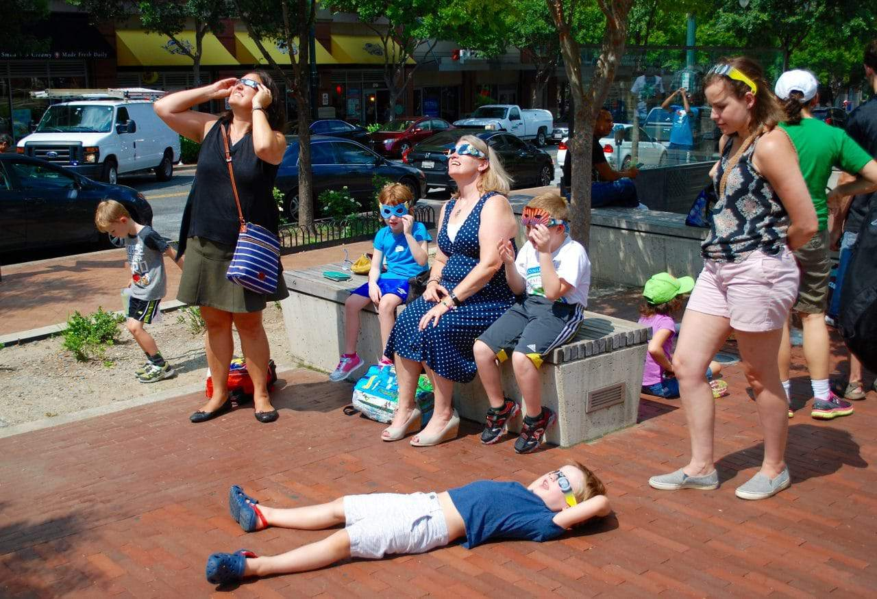 Public spaces popular spots for eclipse viewing - About 75 people gathered on Veterans Plaza in Silver Spring, joining groups gathered in parks and other area open spaces Monday afternoon to watch the solar eclipse.