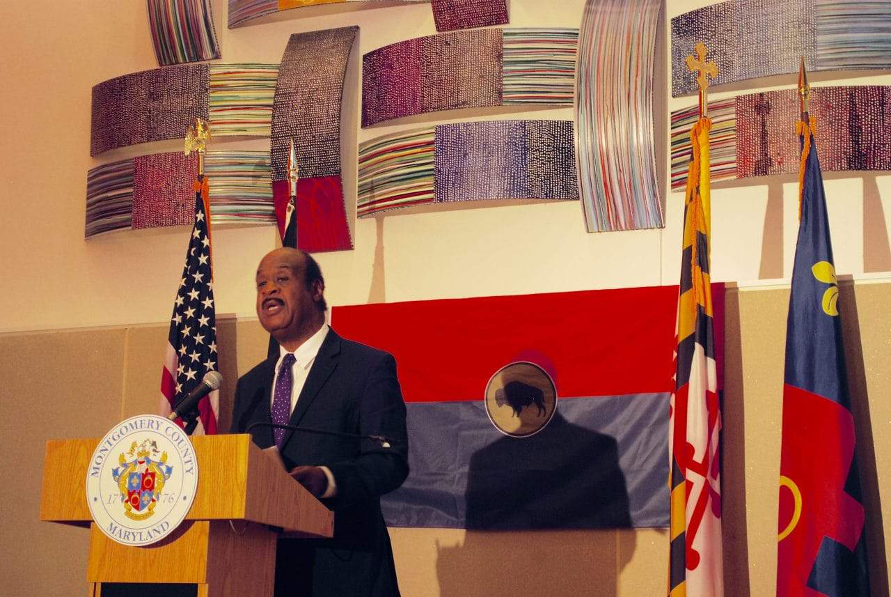 County dedicates Silver Spring hall to honor Buffalo Soldiers - County Executive Ike Leggett speaks in front of the Buffalo Soldiers flag. Photo by Mike Diegel.