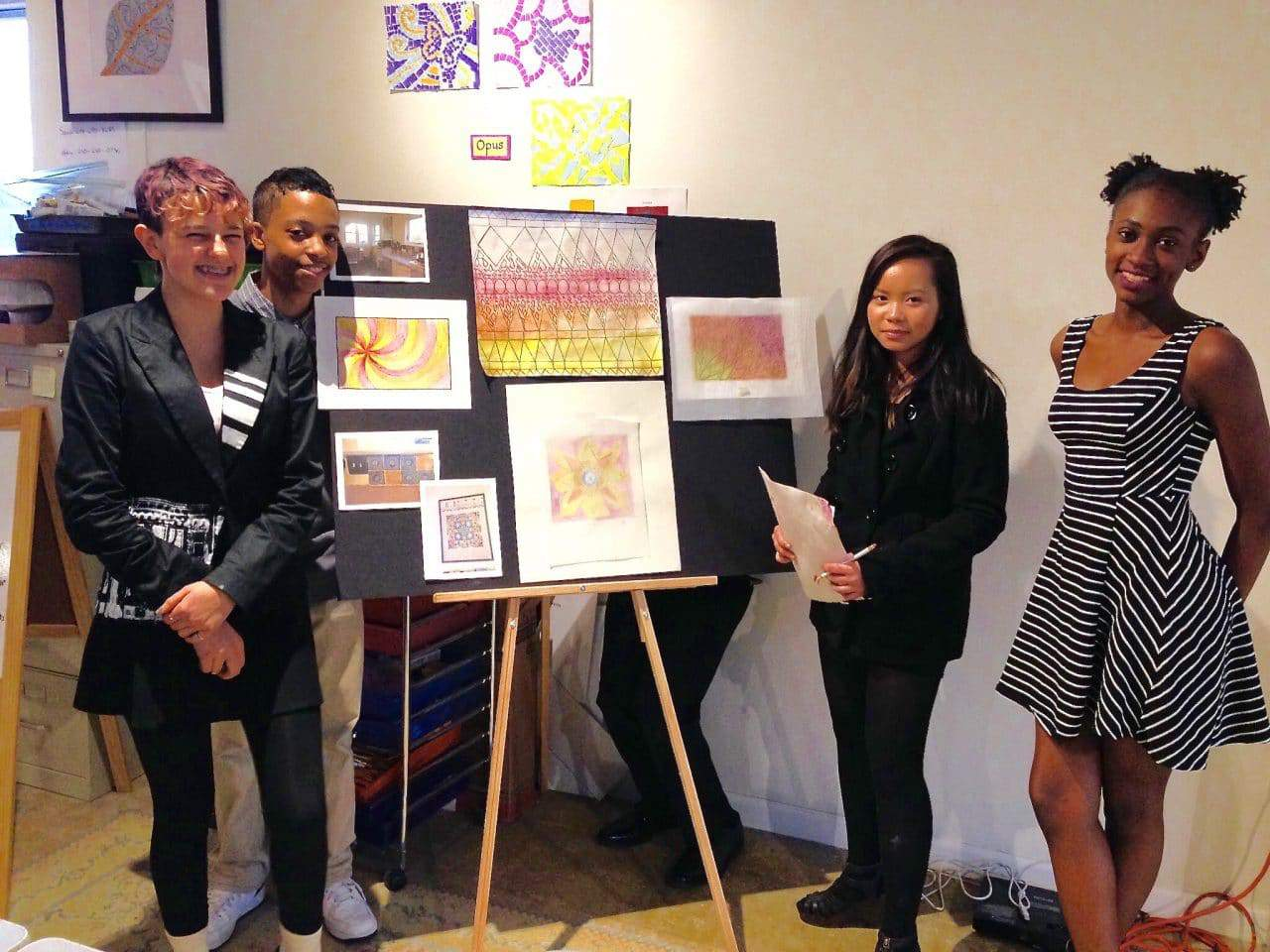 Arts on the Block plans move to Silver Spring Library - AOB apprentice artists show design work to clients. Photo courtesy Arts on the Block.