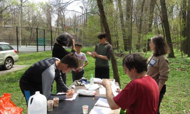 Volunteers mark Earth Day sweeping part of Sligo Creek